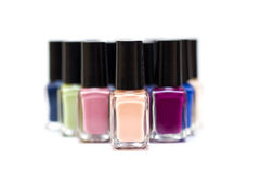 Nail polish bottles on a white background. Coloured nail polish bottles on a white background stock images