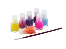 Nail polish and brush Stock Images