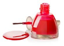 Nail polish and brush isolated Stock Image