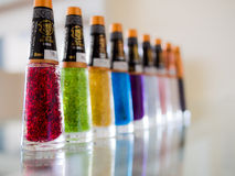 Nail polish. Colorful nail polish bottles on glass Stock Photos