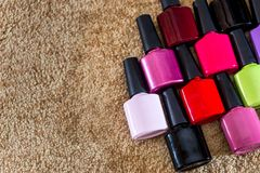 Nail polish colorful on desk. royalty free stock photos