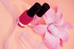 Nail polish colors and flower, cosmetics and spa Stock Image