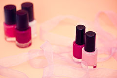 Nail polish colors and flower, cosmetics and spa Stock Images