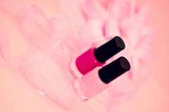 Nail polish colors and flower, cosmetics and spa Stock Photos