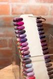Nail Polish Colors. Swatches of Nail Polish colors photographed against a brick wall Stock Image