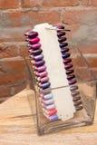 Nail Polish Colors. Swatches of Nail Polish colors photographed against a brick wall Stock Photo