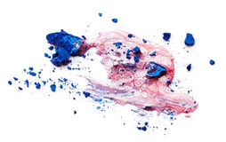 Nail polish and crushed eye shadow Stock Images