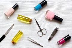Nail polish, cuticle oil and manicure set on wooden background Royalty Free Stock Photos