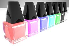 Nail polish of different colors in a row Royalty Free Stock Photo