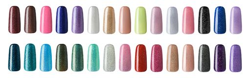 Nail polish in different fashion color. Colorful nail lacquer in tips isolated white background stock image
