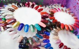 Nail polish in different fashion color wheel royalty free stock photo