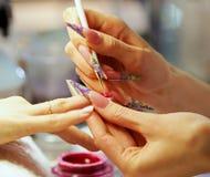 Nail polish drawing Stock Photos