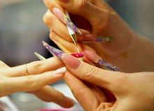 Nail polish drawing Stock Photography