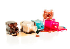 Nail polish dripping from stacked bottles Royalty Free Stock Photography