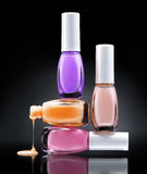 Nail polish dripping from stacked bottles Royalty Free Stock Photos