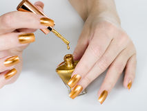 Nail polish with drop Royalty Free Stock Photos