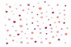 Nail polish drops pattern background in nude pink, peach, red colors. Abstract paint circles background for beauty and