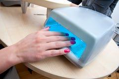 Nail polish dryer. Nail Art Polish UV Gel Acrylic Dryer Stock Photos