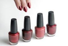 Nail Polish with Fingernails. Row of red nail polish with fingernails Royalty Free Stock Image