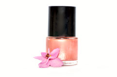 Nail polish with flower. Isolated on white Royalty Free Stock Photos