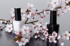 Nail polish with flowers Stock Photography