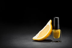Nail polish in foreground Royalty Free Stock Photography