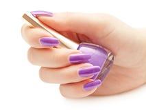 Nail polish in hand Royalty Free Stock Photos
