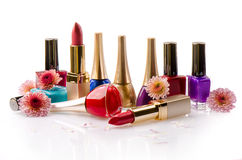 Nail polish and lipstick with flowers Royalty Free Stock Photo