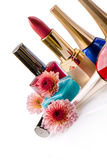 Nail polish and lipstick with flowers Royalty Free Stock Image