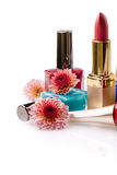 Nail polish and lipstick with flowers Stock Image