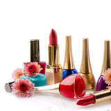 Nail polish and lipstick with flowers Stock Photography