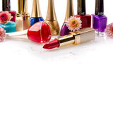 Nail polish and lipstick with flowers Stock Photos