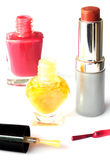 Nail polish and lipstick isolated on white Stock Photos