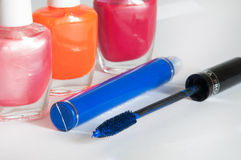 Nail polish and mascara on a white background Stock Images