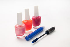 Nail polish and mascara on a white background Royalty Free Stock Photos