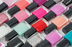 Nail polish. Multi-colored bottles with nail polish laid out on a white background Stock Photo