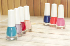 Nail polish. Multi-colored nail polish on the table Royalty Free Stock Images