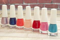 Nail polish. Multi-colored nail polish on the table Stock Image