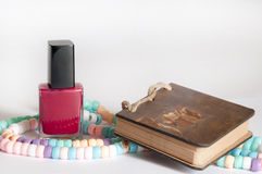 Nail polish with a necklace and notepad Royalty Free Stock Photo