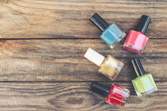 Nail polish. On the old wooden background. Toned image Stock Images