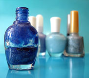 Nail Polish On Blue Royalty Free Stock Image