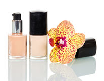 Nail polish with orchid flower isolated on white. Stock Photo