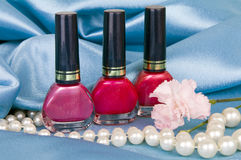 Nail polish and pearls Stock Image