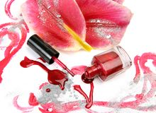 Nail polish and petals of a lily Stock Photo