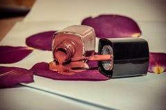 Nail polish and petals Royalty Free Stock Images