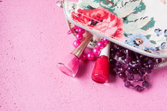 Nail polish on a pink background Royalty Free Stock Photo