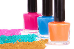 Nail polish and powdery eye shadow Stock Images