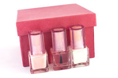 Nail polish and red box. Three bottles of nail polish for French manicure and red box on white background Stock Photos
