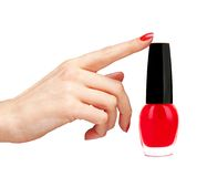 Nail polish of red color and woman hand Royalty Free Stock Photography