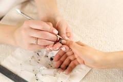 Nail polish removal process Royalty Free Stock Photography